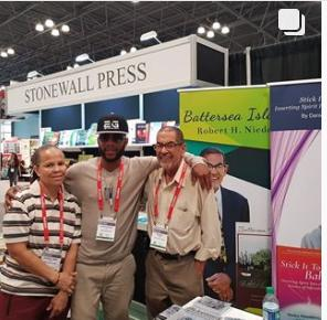 Stonewall Press author with booth in background